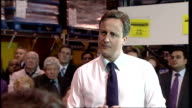 David Cameron at cash and carry in Cardiff Q not much support for job seekers Cameron SOT reinventing enterprise allowance scheme through work...