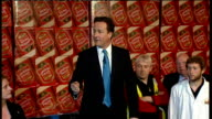 David Cameron visits Fuller's Brewery in Chiswick David Cameron MP speech to workers as standing on wooden factory pallet with backdrop of London...