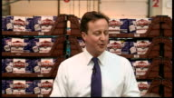 2010 David David Cameron speaks to workers at Warburtons Bakery in Bolton ENGLAND Lancashire Bolton PHOTOGRAPHY * * Warburton Bakery workers crowded...
