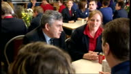 Gordon Brown campaigns in Hastings Gordon Brown entering staff canteen to applause / Brown meeting members of staff SOT / Brown sitting with staff at...