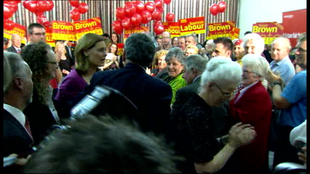 Gordon Brown speech in Dumfries **MUSIC heard over following** Gordon Brown shaking hands with members of audience and waving from podium with Sarah...