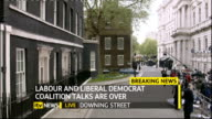 hung parliament fifth day talks ITV News Special PAB 1655 1830 ** COMMERCIAL Downing Street EXT Police officer standing outside entrance to Number 10...