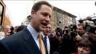 Nick Clegg unveils battle bus ENGLAND London Kilburn EXT Liberal Democrat battle bus arrives/ Nick Clegg MP off battle bus and surrounded by press...