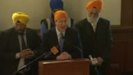 Cameron speaks at Sikh festival in Gravesend SKY ENGLAND Kent Gravesend Gravesend Gurdwara PHOTOGRAPHY *** David Cameron MP to podium / David Cameron...