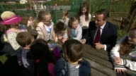 Cameron visits school in Bolton ENGLAND Lancashire Westhoughton near Bolton Sacred Heart Roman Catholic Primary School EXT David Cameron and others...
