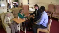 Campaigning ENGLAND South Yorkshire Sheffield Fulwood Lodge Care Home INT Nick Clegg sits chatting with two elderly women during visit to old...