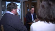 Conservative David Cameron vists Brecon farm Cameron chatting with farmers at table SOT