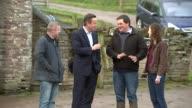 Conservative David Cameron vists Brecon farm WALES Brecon EXT Cars arriving / Prime Minister David Cameron along on farm with local Conservative...