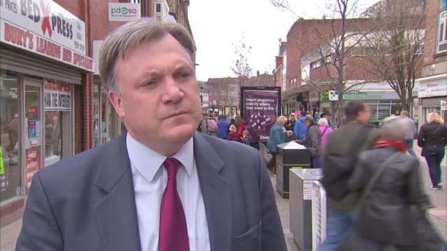 Ed Balls campaigning in Bury EXT Ed Balls interview SOT re NHS funding pledge/ re Labour plans to tackle tax evasion tax avoidance and dondomicile...