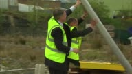 Ed Balls factory visit EXT Varios of Ed Balls shown new collapsible railway signals in factory yard/ Ed Balls interview SOT re HSBC announcement that...