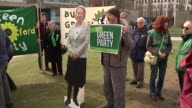 ITV Leaders' Debate Preparations ENGLAND London Embankment EXT Shots of Green Party members posing with posters and cutout of Natalie Bennett in...