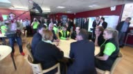 Labour Ed Miliband visits Asda supermarket in Queensferry WALES Queensferry INT Ed Miliband into Asda supermarket and along with others/ various of...