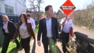 Nick Clegg campaiging in Newton WALES Montgomeryshire Newtown EXT Yellow Liberal Democrat battle bus / Nick Clegg disembraking coach and greeting Lib...
