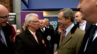 Nigel Farage on walkabout on Canvey Island EXT Farage outside UKIP office with party supporters and councillors / Farage talking to locals / Farage...