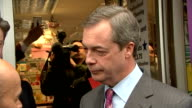 Nigel Farage photocall and shop visit on Canvey Island ENGLAND Essex Canvey Island PHOTOGRAPHY*** Nigel Farage MEP outside UKIP office with party...