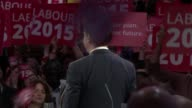 Opinion polls put parties neck and neck Miliband and Cameron campaigning ENGLAND London Westminster INT Ed Miliband along to podium amongst cheering...