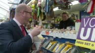 final day of campaigning UKIP ENGLAND Norfolk Great Yarmouth INT Paul Nuttall meeting stallholders as touring indoor market/