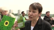 Green Party campaign launch Caroline Lucas interview SOT / Green Party supporters holding manifesto and signs / Lucas interviewed by television crew