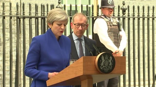 Hung parliament Theresa May Downing Street statement ENGLAND London Downing Street EXT Theresa May MP statement SOT / Theresa and Philip May pose on...