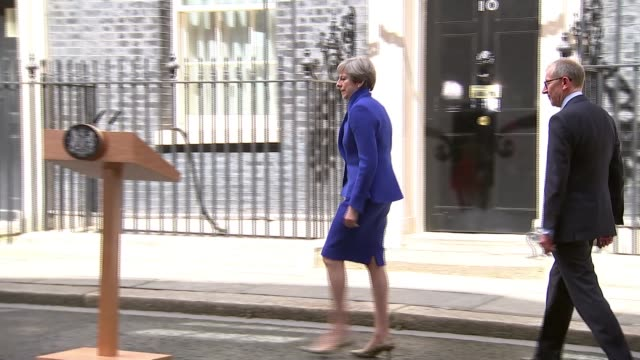 Hung parliament Theresa May to form new government ENGLAND London Downing Street EXT Theresa May MP from car and to press conference podium in...