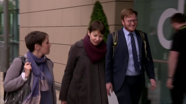 ITV Leaders' Debate Caroline Lucas arrival ENGLAND Greater Manchester Salford EXT Caroline Lucas along and entering building through revolving doors