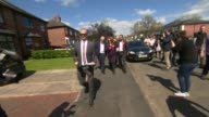 Labour Jeremy Corbyn campaigns in Warrington Corbyn leafleting with local Labour candidate Faisal Rashid including house to house calls posing for...