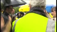 Nicola Sturgeon campaigns in Glasgow EXT Nicola Sturgeon leaving bar and along street into print shop Sturgeon chatting to people and posing for...