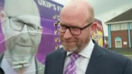 Paul Nuttall unveils UKIP battlebus ENGLAND Lincolnshire Boston EXT UKIP battlebus arriving / Paul Nuttall departing bus and posing for photocall in...