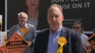 Simon Hughes poster launch ENGLAND London Southwark EXT Various shots Simon Hughes with poster criticizing Tory dementia tax Simon Hughes interview...