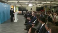 Theresa May and Philip Hammond press conference cutaways ENGLAND London Canary Wharf INT Theresa May and Philip Hammond arrival at podiums for press...