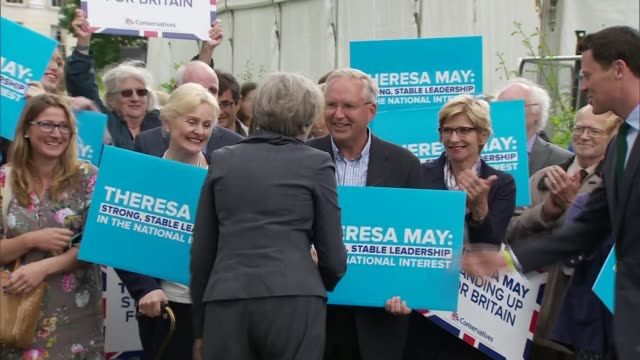 Theresa May in Cheltenham ENGLAND Gloucestershire Cheltenham EXT Tory supporters waiting for May / Theresa May from battle bus and along greeting...