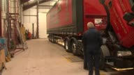 Theresa May in North Berwick SCOTLAND East Lothian North Berwick Andrew Black Haulage INT Theresa May chatting with workers / Men by lorry / May...