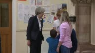 Theresa May meets parents in Ripon ITN POOL ENGLAND North Yorkshire Ripon INT Theresa May meeting parents and children in village hall