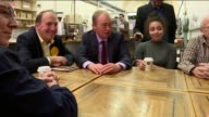 Tim Farron and Simon Hughes in Southwark Tim Farron and Simon Hughes seated with people in bakery and with croissants Tim Farron interview SOT