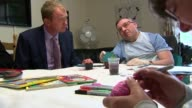 Tim Farron in Southport ENGLAND Merseyside Southport INT Tim Farron arriving at care home / Farron chatting to people around table in care home