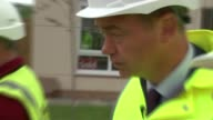 Tim Farron visits construction site in Warrington ENGLAND Cheshire Warrington EXT Tim Farron MP being shown around building site where affordable...