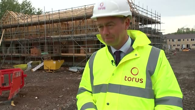 Tim Farron visits construction site in Warrington Tim Farron interview SOT On launch of Lib Dem housing strategy