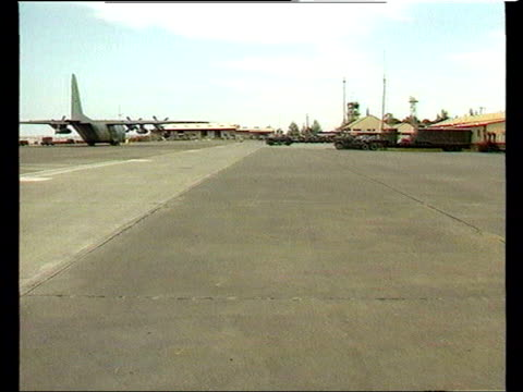 General election LIB US Air Force Base Entrance to 'HQ US Forces Incirlik' Runway with planes in distance PAN to Hercules