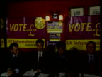 Minor parties ITN ENGLAND London Westminster Independence Party battle bus along past parliament UKIP Battle bus along Livery on back of bus 'Keep...