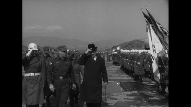 General James Van Fleet and US ambassador to South Korea Ellis O Briggs review South Korean troops with a military band in Seoul Korea during...