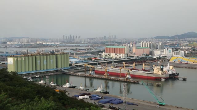General Motors Co Chevrolet automobiles bound for export sit parked at the Port of Incheon in Incheon South Korea on Monday Sept 4 A cargo ship and a...