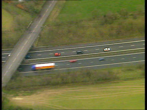 Air views of convoy of cars taking General Pinochet to military airbase in Lincolnshire for flight home to Chile