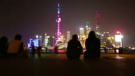General public overlooking The Bund and Huangpu River, Shanghai, China