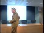 INT General Sir Michael Walker along into room for press conference PAN General Sir Michael Walker press conference SOT If they spot a weakness they...