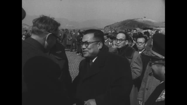 General Van Fleet salutes and shakes hands with military police / enters a car / Van Fleet and Briggs meeting South Korean National Assembly members...