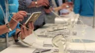 General view visitors inspect Samsung smartphones and mobile devices decorated with Swarovski crystals at the Samsung Eletronics Co display area at...