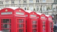 General views a row of red British Telecom fixed line telephone boxes in London UK on Thursday May 29 Close shot coins are inserted into slot inside...