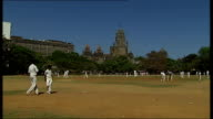 General views and cricket practice in Mumbai Cricket match in progress on pitch / Practice shots taken from behind stumps and nets