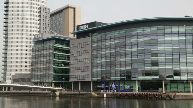 General views BBC logos sit atop BBC Bridge House and BBC Quay House in the MediaCityUK property development at Salford Quays Greater Manchester UK...