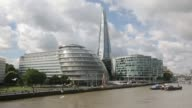 General views City Hall center and More London right stand on the south bank of the River Thames as the Shard tower rises beyond in London UK on...